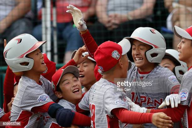 Seiya Arai of Japan celebrates scoring the game ending run during their 122 win over the Southwest Team from Texas during the Champioinship Game of...