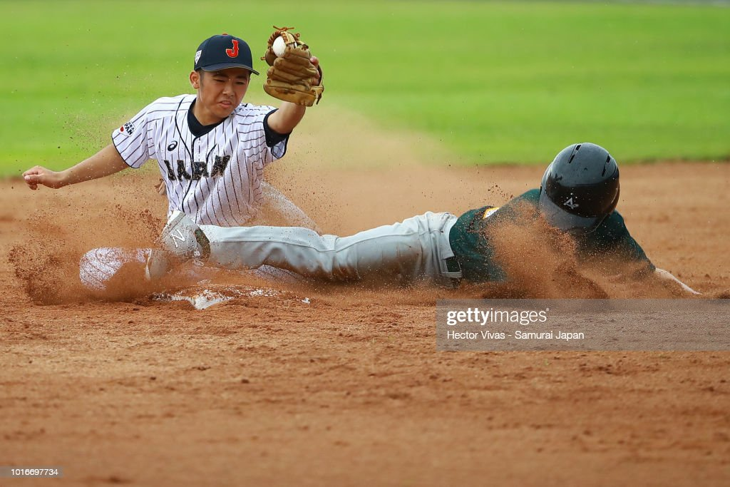 Seiya Fukuhara #12 of Japan tagged out Nikau Pouaka Greco #3 of Australia during the WBSC U-15 World Cup Group B match between Australia and Japan at Estadio Rico Cedeno on August 10, 2018 in Chitre, Panama.