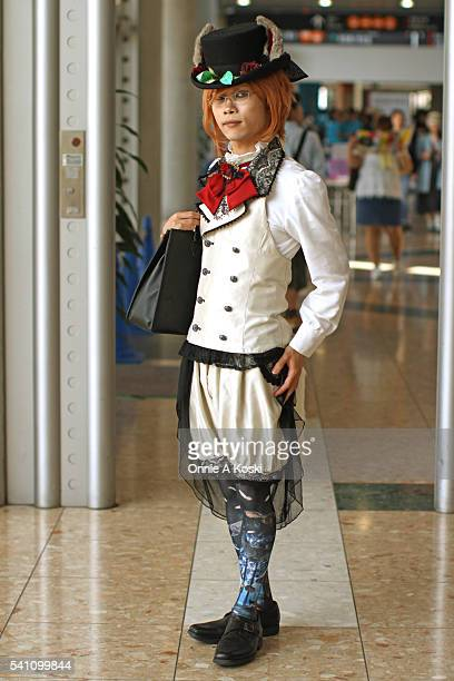 Seiya is wearing a black top hat with animal ears and rose accent a white four buttoned doublebreasted vest with black lace collar a red bow with...