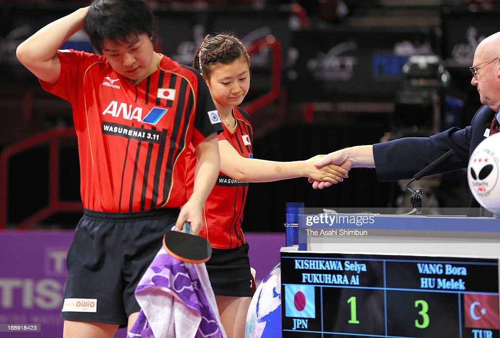 Seiya Kishikawa (L) and Ai Fukuhara of Japan leave as they were beaten by Bora Vang and Melek Hu of Turkey in the Mixed Doubles 3rd round match during day four of the World Table Tennis Championships on May 16, 2013 in Paris, France.