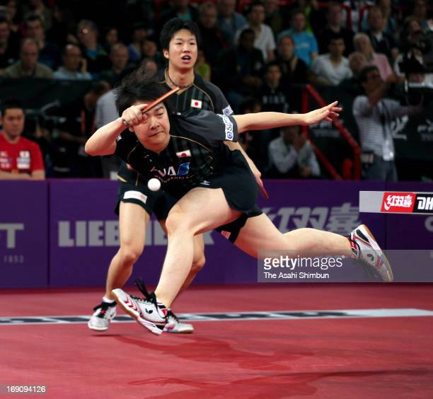 Seiya Kishikawa and Jun Mizutani of Japan competes in the Men's Doubles Semi Final match against Hao Shuai and Ma Lin of China during day six of the...