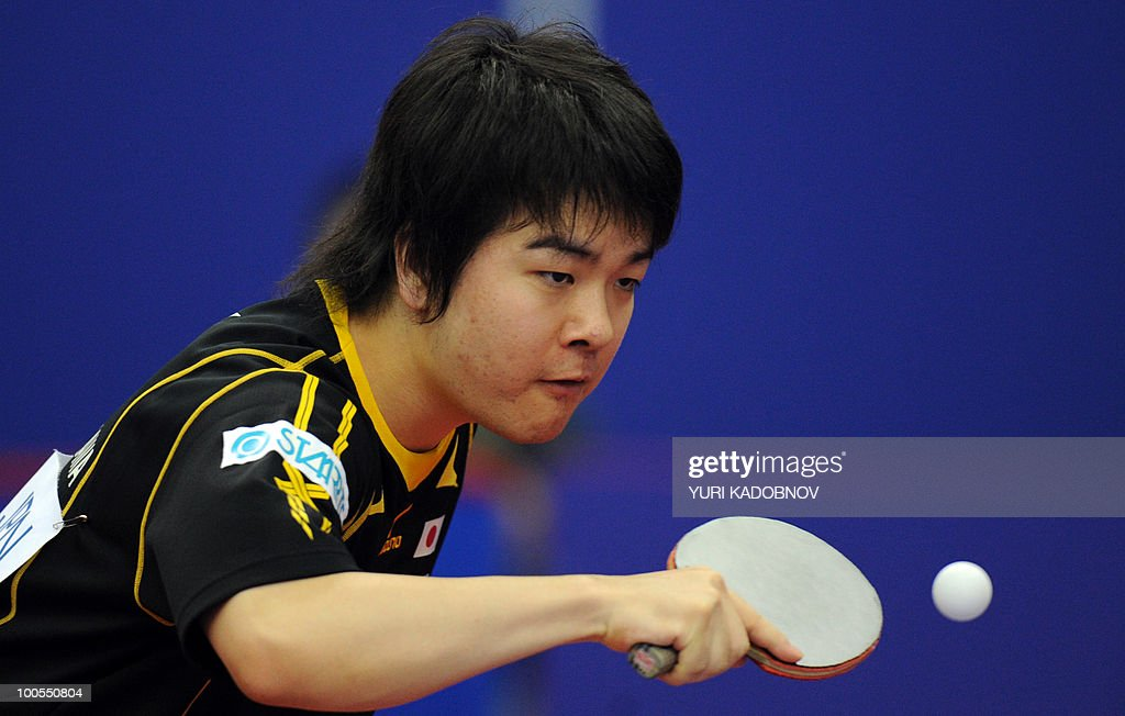 Seiya Kishikawa of Japan returns a service to Allan Bentsen of Denmark during their men's teams group C match at the 2010 World Team Table Tennis Championships in Moscow on May 25, 2010.