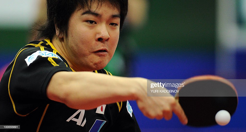 Seiya Kishikawa of Japan returns a servi