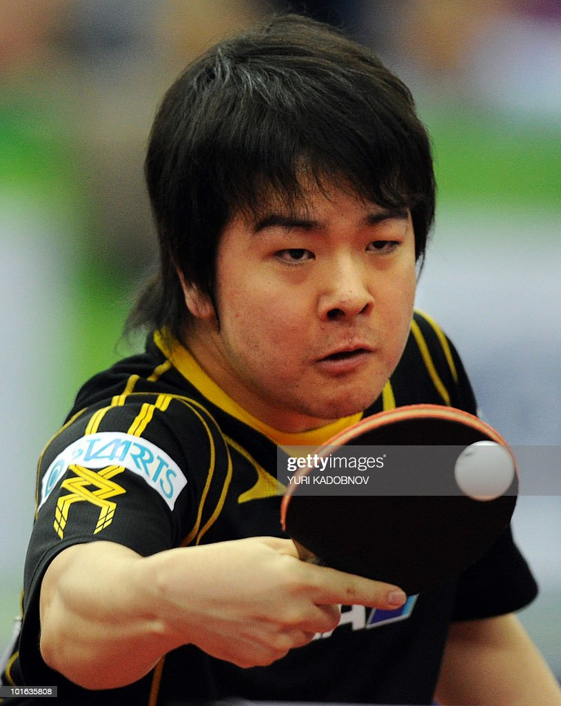 Seiya Kishikawa of Japan services to Jike Zhang of China during the men's semi final at the 2010 World Team Table Tennis Championships in Moscow on May 29, 2010.