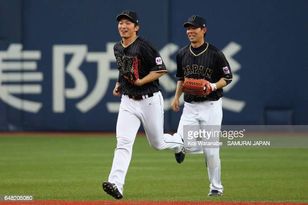 Seiya Suzuki and Outfielder Shogo Akiyama of Japan celebrate their win after the World Baseball Classic WarmUp Game between Japan and Orix Buffaloes...