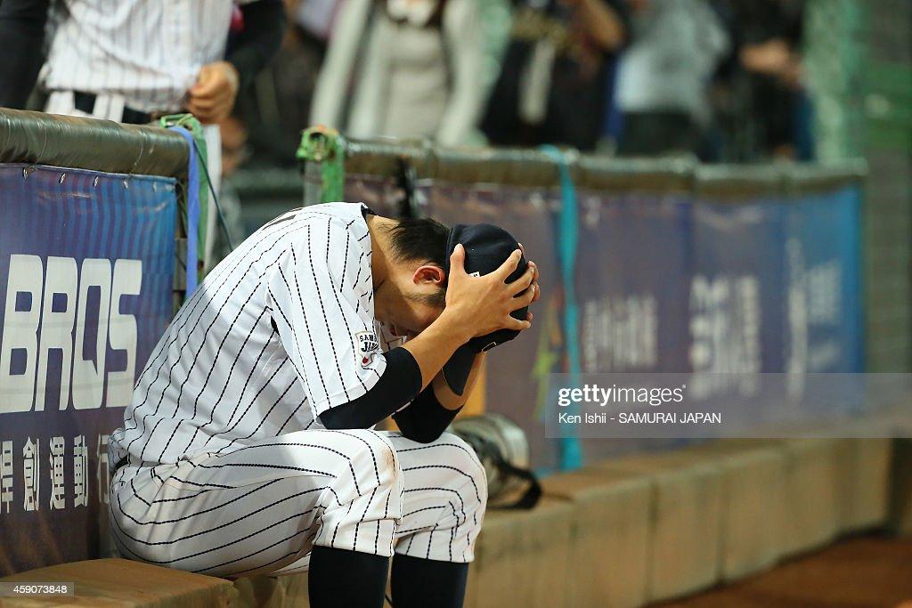 Seiya Suzuki of Japan reacts after losing Chinese Taipei during the IBAF 21U Baseball World Cup Final between Japan and Chinese Taipei at Taichung Intercontinental Baseball Stadium on November 16, 2014 in Taichung, Taiwan.