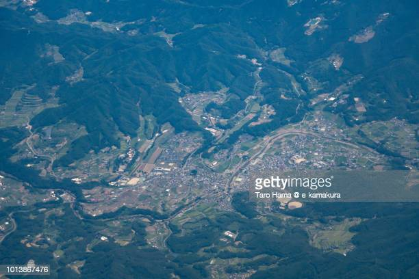 Seiyo city in Ehime prefecture in Japan daytime aerial view from airplane
