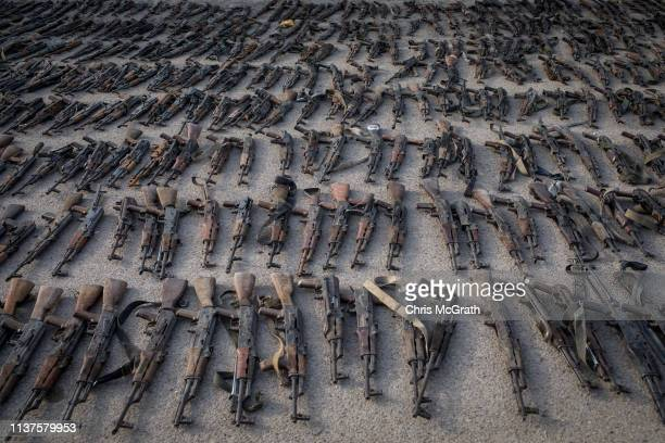 Seized ISIL weapons that were found in the last stronghold of the extremist group are displayed at an SDF base on March 22 2019 outside Al Mayadin...