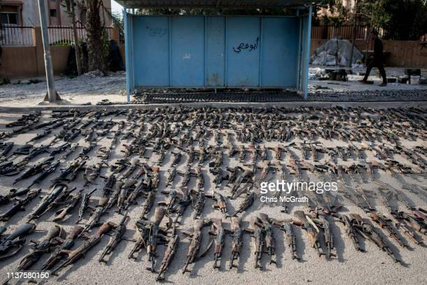 Seized ISIL weapons that were found in the last stronghold of the extremist group are displayed at an SDF base on March 22, 2019 outside Al Mayadin,...