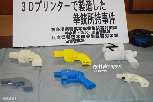 Seized plastic made guns produced by a 3D printer are displayed at a police station in Yokohama on May 8 2014 A Japanese man suspected of possessing...