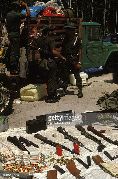 Seizing weapons from the drug guerrilla after the capture of a clandestine laboratory in Colombia in February , 1988.