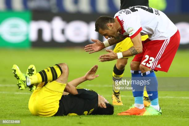 Sejad Salihovic of Hamburg argues with Shinji Kagawa of Dortmund during the Bundesliga match between Hamburger SV and Borussia Dortmund at...