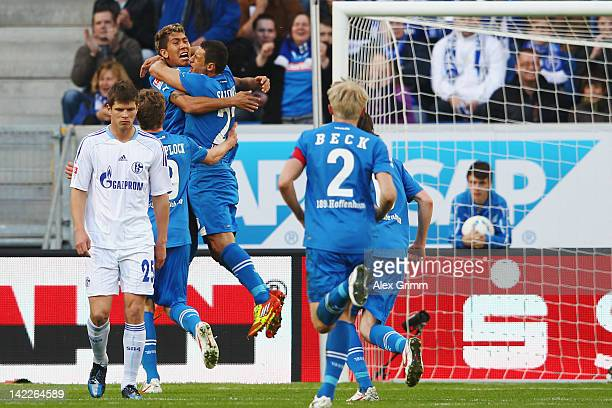 Sejad Salihovic of Hoffenheim celebrates his team's first goal with team mate Roberto Firmino as Klaas-Jan Huntelaar of Schalke reacts during the...