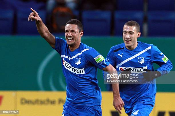 Sejad Salihovic of Hoffenheim celebrates scoring the opening goal with his team mate Fabian Johnson during the DFB Cup round of sixteen match between...