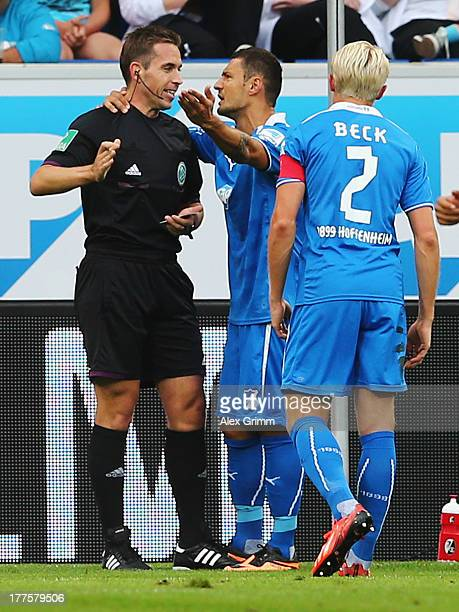 Sejad Salihovic of Hoffenheim discusses with referee Tobias Stieler after being sent off during the Bundesliga match between 1899 Hoffenheim and SC...