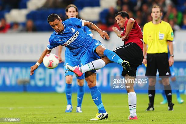 Sejad Salihovic of Hoffenheim is challenged by Sergio da Silva Pinto of Hannover during the Bundesliga match between 1899 Hoffenheim and Hannover 96...