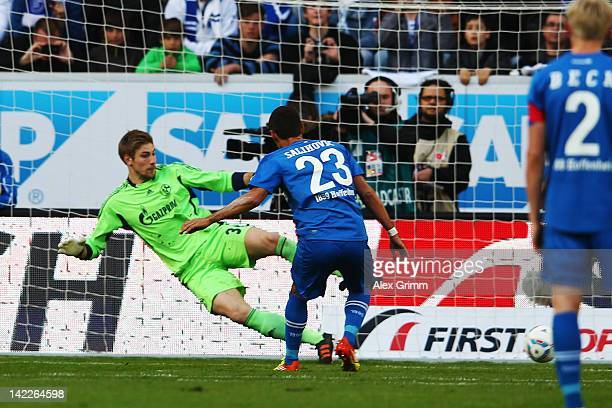 Sejad Salihovic of Hoffenheim scores his team's first goal with a penalty against goalkeeper Lars Unnerstall of Schalke during the Bundesliga match...
