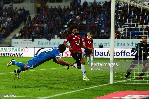 Sejad Salihovic of Hoffenheim scores his team's second goal against Felipe and goalkeeper RonRobert Zieler of Hannover during the Bundesliga match...