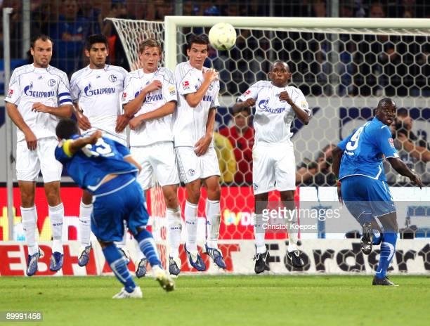 Sejad Salihovic of Hoffenheim shoots a freekick over the wall of Schalke during the Bundesliga match between 1899 Hoffenheim and FC Schalke 04 at...