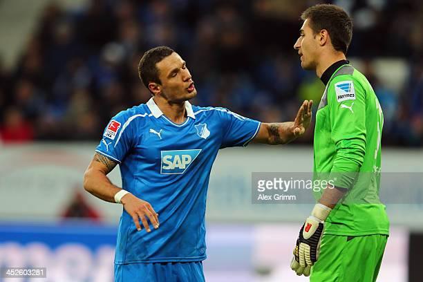 Sejad Salihovic of Hoffenheim talks to goalkeeper Koen Casteels during the Bundesliga match between 1899 Hoffenheim and Werder Bremen on November 30...