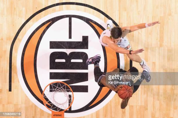 Sek Henry of the Breakers goes to the basket over Dane Pineau of the Phoenix during the round 20 NBL match between the New Zealand Breakers and the...