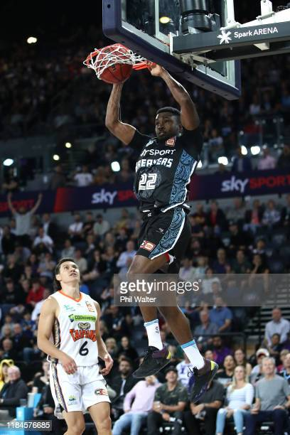 Sek Henry of the Breakers slams the ball during the round five NBL match between the New Zealand Breakers and the Cairns Taipans at Spark Arena on...
