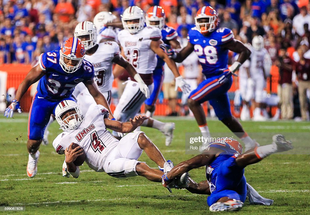 Sekai Lindsay #4 of the Massachusetts Minutemen is tackled during the second half of the game against the Florida Gators at Ben Hill Griffin Stadium on September 3, 2016 in Gainesville, Florida.