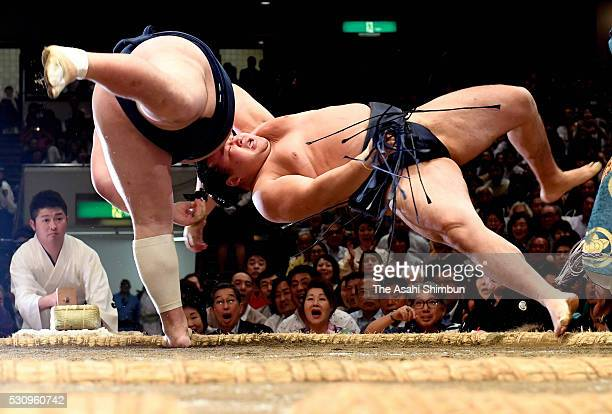 Sekiwake Ikioi throws Mongolian yokozuna Kakuryu to win during day five of the Grand Sumo Summer Tournament at Ryogoku Kokugikan on May 12 2016 in...