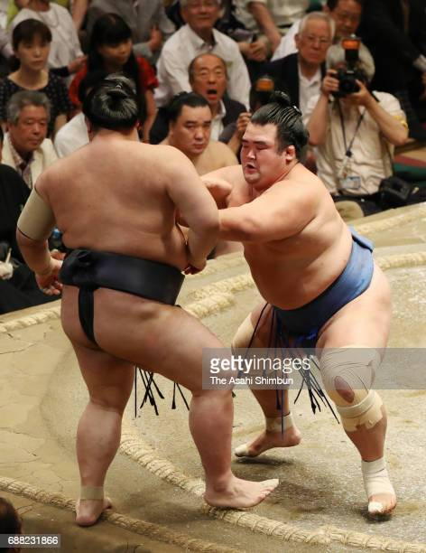 Sekiwake Kotoshogiku pushes yokozuna Kisenosato out of the ring to win during day ten of the Grand Sumo Summer Tournament at Ryogoku Kokugikan on May...