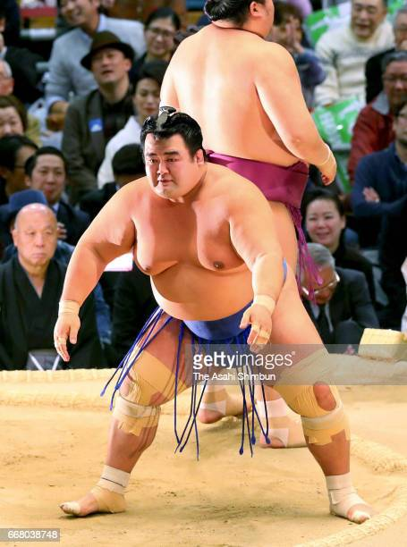 Sekiwake Kotoshogiku reacts after his defeat by Takarafuji during day twelve of the Grand Sumo Spring Tournament at Edion Arena Osaka on March 23...