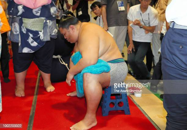 Aminishiki reacts after his victory over Kizenryu in a juryo rank bout on day twelve of the Grand Sumo Nagoya Tournament at the Dolphin's Arena on...
