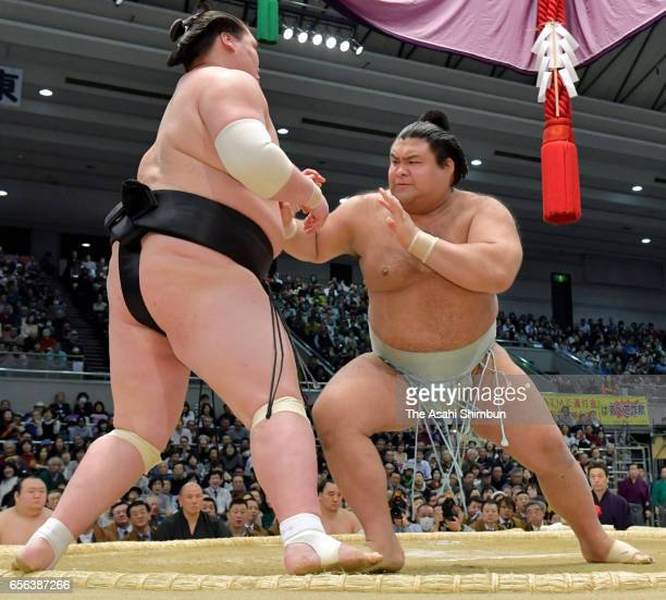 Sekiwake Takayasu pushes Mongolian ozeki Terunofuji out of the ring to win during day six of the Grand Sumo Spring Tournament at Edion Arena Osaka on...