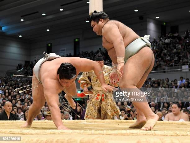 Sekiwake Takayasu throws Mongolian Takanoiwa to win during day ten of the Grand Sumo Spring Tournament at Edion Arena Osaka on March 21 2017 in Osaka...