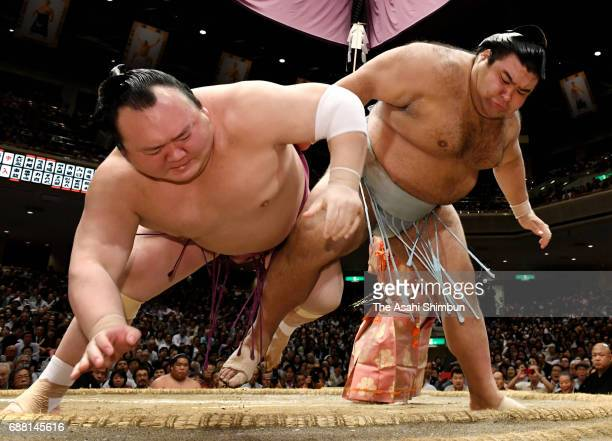 Sekiwake Takayasu throws Takarafuji to win during day twelve of the Grand Sumo Summer Tournament at Ryogoku Kokugikan on May 25 2017 in Tokyo Japan