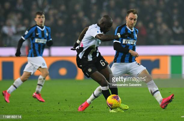 Seko Fofana of Udinese Calcio competes for the ball with Christian Eriksen of FC Internazionale during the Serie A match between Udinese Calcio and...