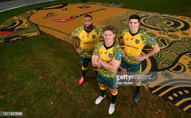 Sekope Kepu Michael Hooper and Jack Maddocks of Australia pose alongside a giant indigenous Wallabies jersey at the Lensbury on November 22 2018 in...