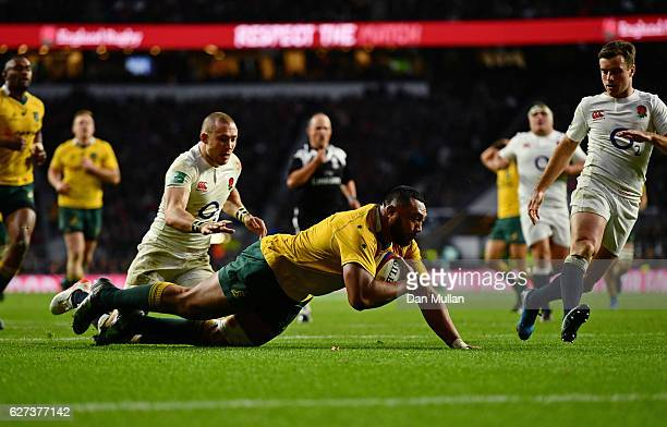 Sekope Kepu of Australia celebrates scoring his sides third try as Mike Brown of England attempts to catch him during the Old Mutual Wealth Series...