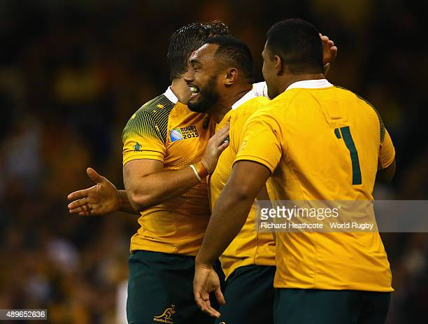 Sekope Kepu of Australia celebrates scoring his teams third try with team mates during the 2015 Rugby World Cup Pool A match between Australia and...