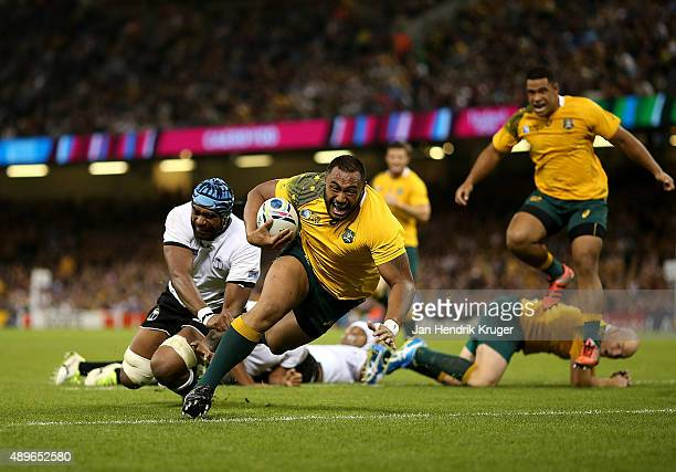 Sekope Kepu of Australia goes over for his try during the 2015 Rugby World Cup Pool A match between Australia and Fiji at Millennium Stadium on...