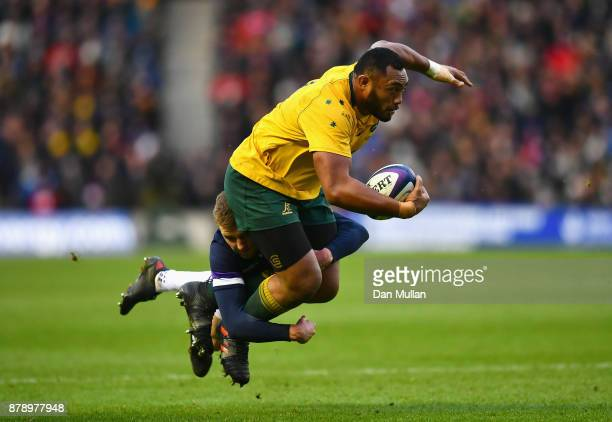Sekope Kepu of Australia is tackled by Finn Russell of Scotland during the international match between Scotland and Australia at Murrayfield Stadium...