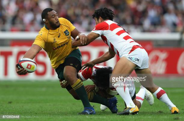 Sekope Kepu of Australia off loads during the rugby union international match between Japan and Australia Wallabies at Nissan Stadium on November 4...