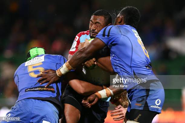 Sekope Kepu of the Waratahs gets tackled by Adam Coleman and Isireli Naisarani of the Force during the round 17 Super Rugby match between the Force...