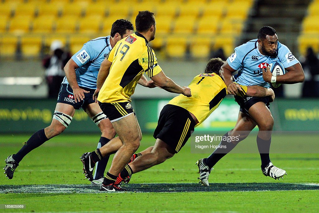 Sekope Kepu of the Waratahs is tackled by Reggie Goodes of the Hurricanes during the round eight Super Rugby match between the Hurricanes and the Waratahs at Westpac Stadium on April 6, 2013 in Wellington, New Zealand.
