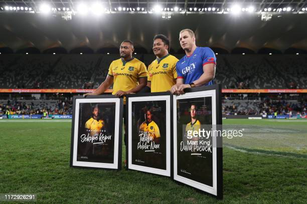 Sekope Kepu, Tatafu Polota-Nau and David Pocock of the Wallabies pose after playing their last Test in Australia during the International Test match...