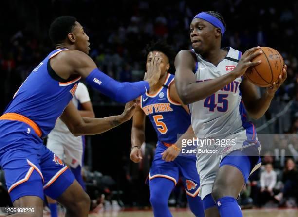 Sekou Doumbouya of the Detroit Pistons drives the lane against RJ Barrett of the New York Knicks during the second half at Little Caesars Arena on...