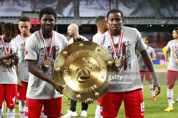Sekou Koita and Mohamed Camara of Salzburg celebrating with the austrian soccer championships trophy prior the tipico Bundesliga match between Red...