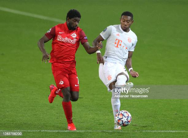 Sekou Koita of RB Salzburg and David Alaba of Bayern Munich clash during the UEFA Champions League Group A stage match between RB Salzburg and FC...