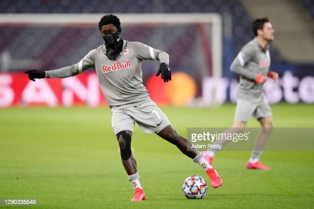 Sekou Koita of RB Salzburg warms up wearing a face mask ahead of the UEFA Champions League Group A stage match between RB Salzburg and Atletico...