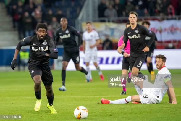 Sekou Koita of Red Bull Salzburg and David Abraham of Eintracht Frankfurt during the UEFA Europa League round of 32 second leg match between RB...