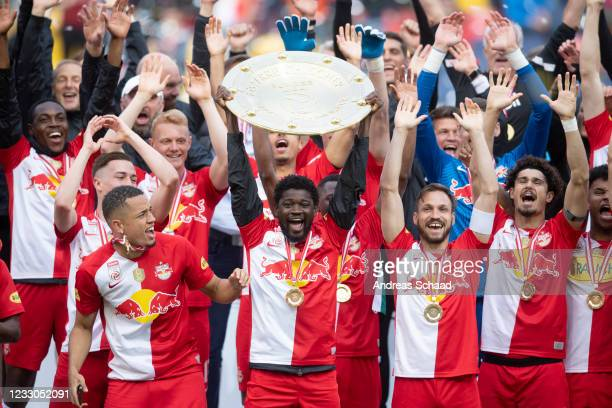 Sekou Koita of Red Bull Salzburg celebrates with the trophy for winning the Austrian Soccer Championship after the tipico Bundesliga match between RB...